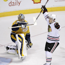 Chicago Blackhawks right wing Ben Smith, right, celebrates after scoring against Nashville Predators goalie Pekka Rinne, of Finland, during the first period of an NHL hockey game Saturday, April 12, 2014, in Nashville, Tenn The Associated Press