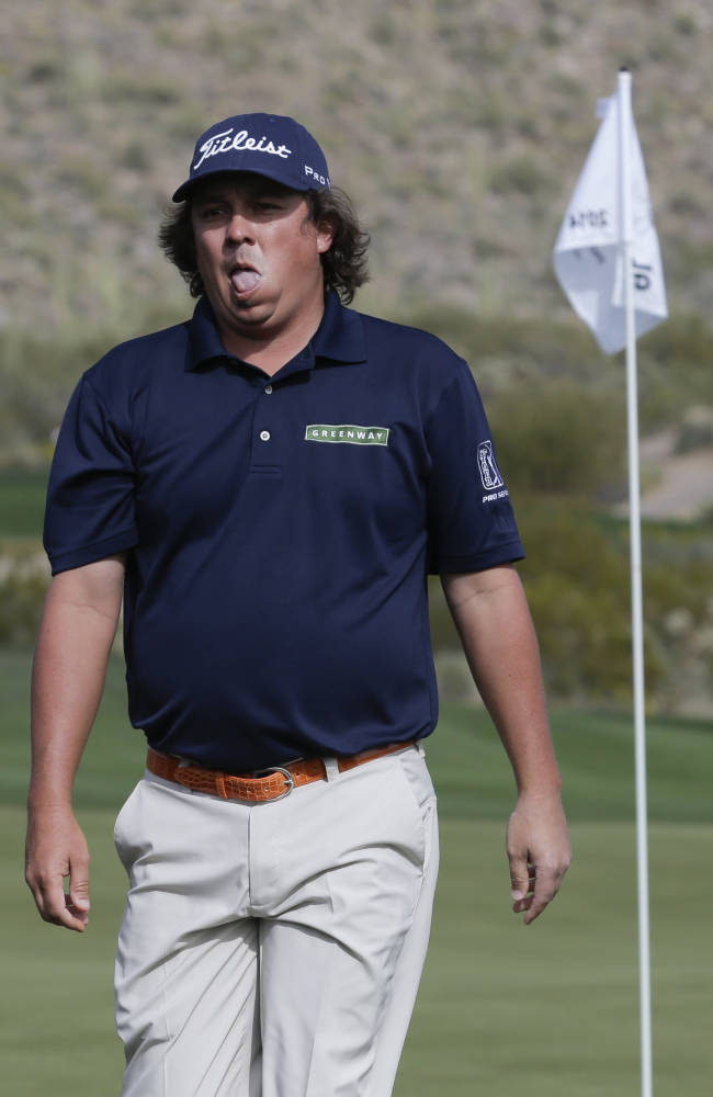 Jason Dufner, reacts to a putt on the 16th hole in during his match against Scott Stallings during the first round of the Match Play Championship golf tournament on Wednesday, Feb. 19, 2014, in Marana, Ariz