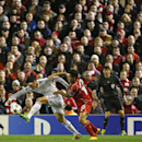 Real Madrid's James Rodriguez, holds off Liverpool's Philippe Coutinho during the Champions League group B soccer match between Liverpool and Real Madrid at Anfield Stadium, Liverpool, England, Wednesday Oct. 22, 2014