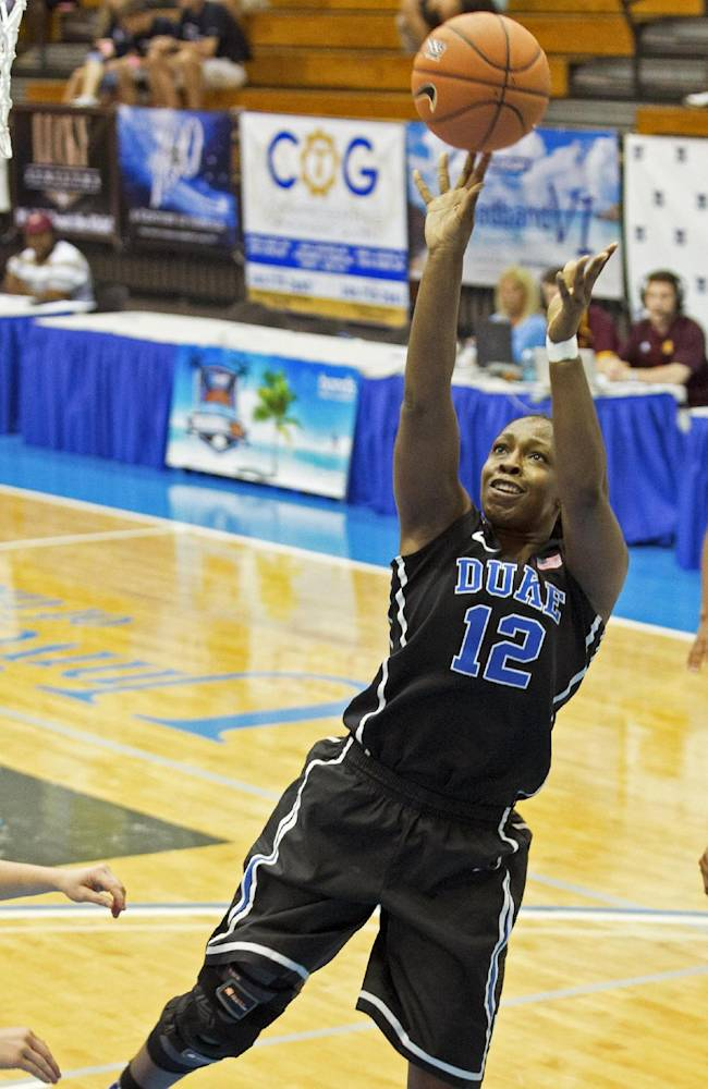 Duke's Chelsea Gray, center, shoots for the basket against Central Michigan during the first half of an NCAA college basketball game in St. Thomas, U.S. Virgin Islands, Friday, Nov. 29, 2013. Duke won 97-64