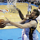 Memphis Grizzlies center Marc Gasol (33) is fouled by Oklahoma City Thunder forward Serge Ibaka (9) as he goes up for a shot in the third quarter of Game 2 of an opening-round NBA basketball playoff series in Oklahoma City, Monday, April 21, 2014. Memphis