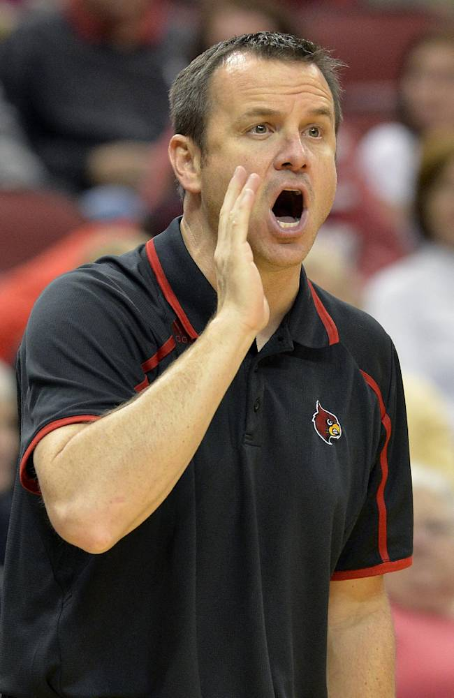 Louisville head coach Jeff Walz shouts during the first half of an NCAA college exhibition game against Pikeville, Tuesday, Nov. 5, 2013, in Louisville, Ky. Louisville defeated Pikeville 127-40