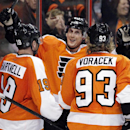 Philadelphia Flyers' Scott Hartnell, Vincent Lecavalier and Jakub Voracek, from left, celebrate Lecavalier's goal during the second period of an NHL hockey game against the Buffalo Sabres, Sunday, April 6, 2014, in Philadelphia. The Flyers won 5-2 The Ass