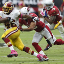 Washington Redskins running back Alfred Morris (46) escapes the reach of Arizona Cardinals strong safety Tony Jefferson during the first half of an NFL football game, Sunday, Oct. 12, 2014, in Glendale, Ariz The Associated Press