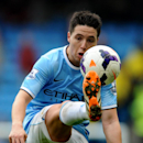 Manchester City's Samir Nasri contols the ball with a high kick during the English Premier League soccer match between Manchester City and Southampton at The Etihad Stadium, Manchester, England, Saturday, April 5, 2014