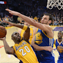 Los Angeles Lakers guard Jodie Meeks, left, puts up a shot as Golden State Warriors center Andrew Bogut, of Australia, defends during the second half of an NBA basketball game, Friday, Nov. 22, 2013, in Los Angeles The Associated Press