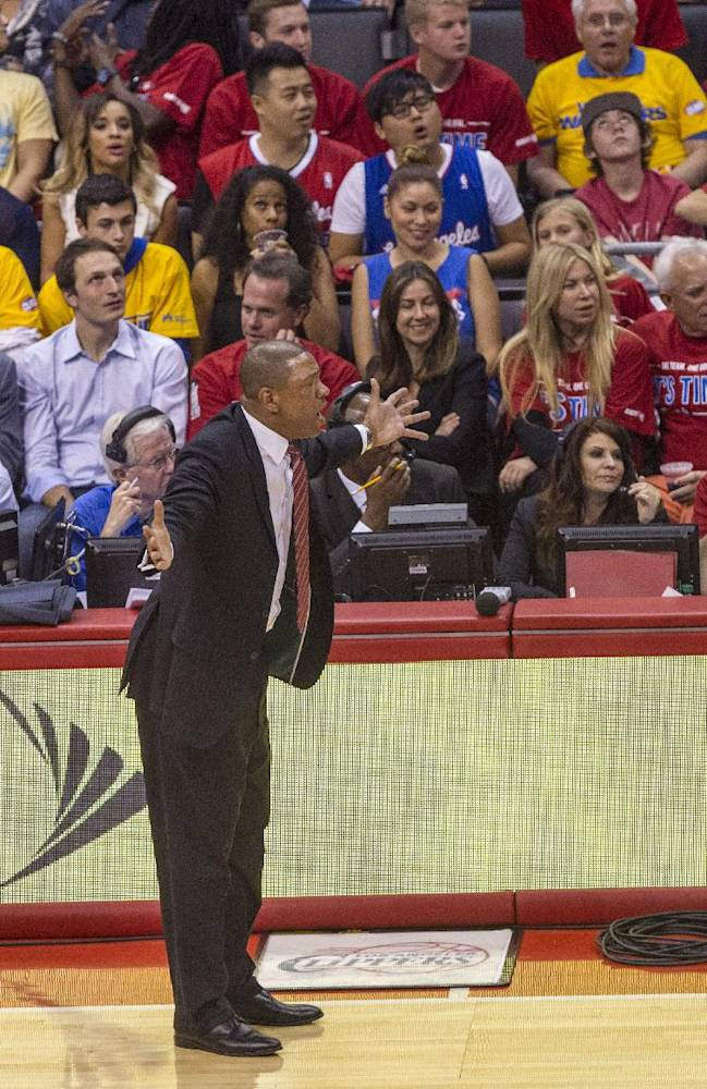 Los Angeles Clippers head coach Doc Rivers reacts to a call during the first half of Game 7 of a first-round NBA basketball playoff series against Golden State Warriors, Saturday, May 3, 2014, in Los Angeles