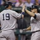 New York Yankees' Brett Gardner, right, high-fives teammate Chris Stewart after Gardner hit a two-run home run off Tampa Bay Rays starting pitcher Roberto Hernandez in the fourth inning of a baseball game, Friday, May 24, 2013, in St. Petersburg, Fla. (AP Photo/Chris O'Meara)