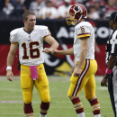 Washington Redskins quarterback Colt McCoy (16) fist-bumps quarterback Kirk Cousins (8) during the first half of an NFL football game against the Arizona Cardinals, Sunday, Oct. 12, 2014, in Glendale, Ariz The Associated Press