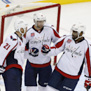 From left to right, Washington Capitals' Brooks Laich, Eric Fehr and Joel Ward celebrate Laich's open-net goal against the New Jersey Devils during the third period of an NHL hockey game, Saturday, Dec. 6, 2014, in Newark, N.J. The Capitals won 4-1 The As