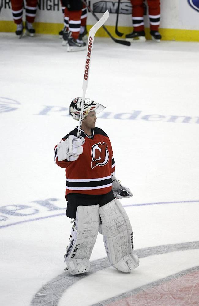 New Jersey Devils goalie Martin Brodeur waves to the crowd after an NHL hockey game against the Boston Bruins in Newark, N.J., Sunday, April 13, 2014. The Devils won 3-2