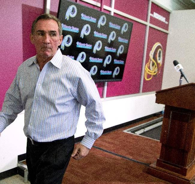Former Washington Redskins head coach Mike Shanahan walks away from the podium after making a statement after he was fired on Monday, Dec. 30, 2013, at Redskins Park, in Ashburn, Va. Shanahan was fired after a morning meeting with owner Dan Snyder and general manager Bruce Allen