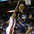 Indiana Pacers' C.J. Watson (32) goes to the basket past Miami Heat's Rashard Lewis (9) during the first half of an NBA basketball game, Friday, April 11, 2014, in Miami The Associated Press