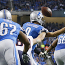 Chicago Bears defensive end Jared Allen jars the ball out of Detroit Lions quarterback Matthew Stafford's control during the first half of an NFL football game in Detroit, Thursday, Nov. 27, 2014 The Associated Press