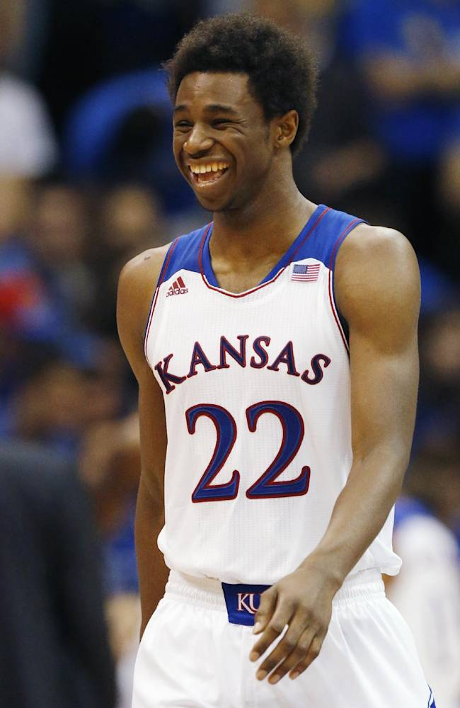 Kansas guard Andrew Wiggins smiles after a basket during the second half of an exhibition NCAA college basketball game against Pittsburg State in Lawrence, Kan., Tuesday, Oct. 29, 2013. Wiggins scored 16 points as Kansas won 97-57