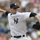 McCarthy gets 1st win with Yankees, 7-1 over Reds The Associated Press