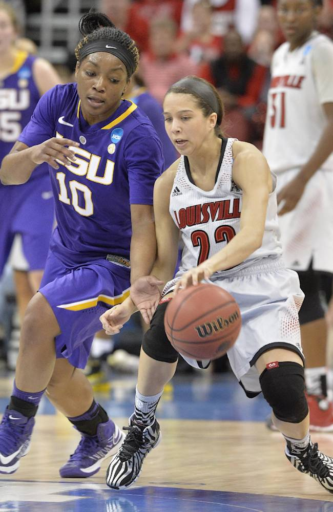 LSU's Jasmine Rhodes, left, attempts to steal the ball from Louisville's Jude Schimmel during the first half in a regional semifinal game at the NCAA women's college basketball tournament on Sunday, March 30, 2014, in Louisville, Ky