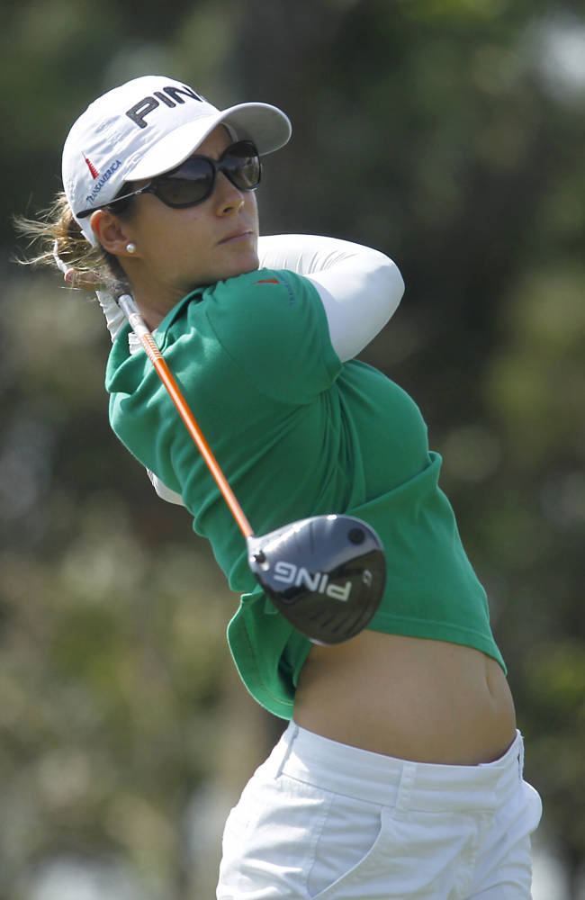 Azahara Munoz of Spain tees off the 3rd hole during the last day of the LPGA Taiwan Championship tournament at the Sunrise Golf & Country Club, Sunday, Oct. 27, 2013, in Yangmei, northern Taiwan