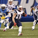 New England Patriots wide receiver Julian Edelman moves up field against the San Diego Chargers during the second half in an NFL football game Sunday, Dec. 7, 2014, in San Diego The Associated Press