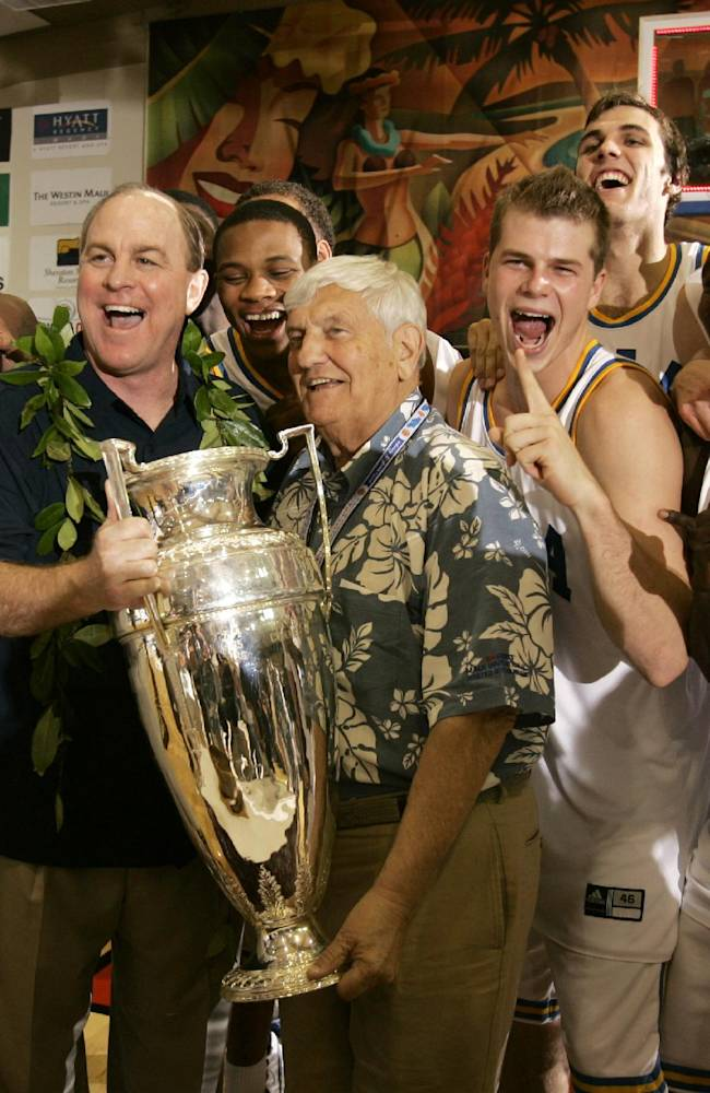 In this Nov. 22, 2006, file photo, UCLA coach Ben Howland, second from left, and his team is presented with the championship trophy by Wayne Duke, tournament chairmen emeritus, after UCLA defeated Georgia Tech 88-73 in the championship game at the Maui Invitational college basketball tournament in Lahaina, Hawaii. The Maui Invitational turns 30 this week
