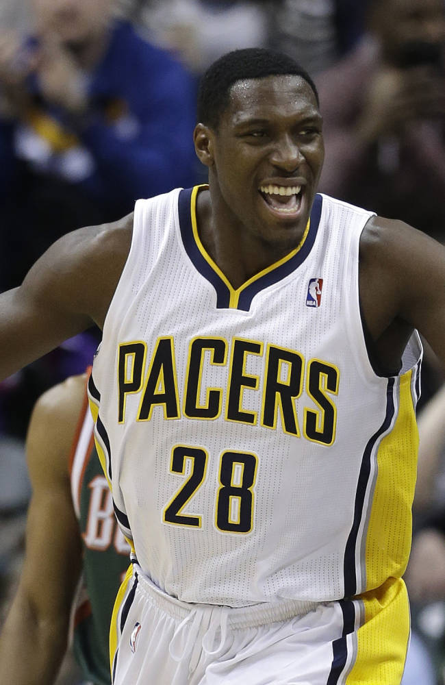 Indiana Pacers' Ian Mahinmi celebrates following a dunk during the first half of an NBA basketball game against the Milwaukee Bucks, Thursday, Feb. 27, 2014, in Indianapolis