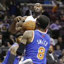 Detroit Pistons guard Rodney Stuckey is fouled by New York Knicks guard J.R. Smith (8) during the second half of an NBA basketball game in Auburn Hills, Mich., Monday, March 3, 2014 The Associated Press