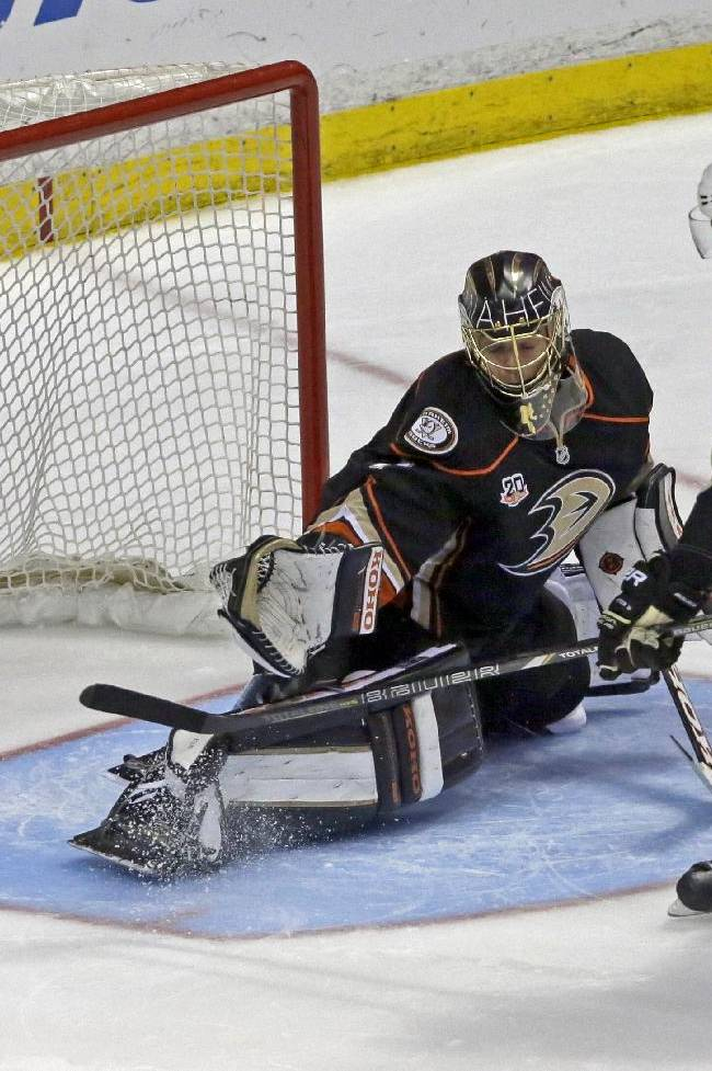 Pittsburgh Penguins center Brandon Sutter (16) shoots what became the winning goal in a shootout over Anaheim Ducks goalie Jonas Hiller (1), of Switzerland, in a shootout in an NHL hockey game in Anaheim, Calif., Friday, March 7, 2014.  The Penguins won in a shootout, 3-2