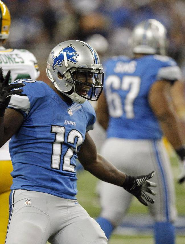 Detroit Lions wide receiver Jeremy Ross (12) reacts after a run during the second quarter of an NFL football game against the Green Bay Packers at Ford Field in Detroit, Thursday, Nov. 28, 2013