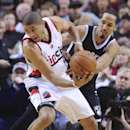 Brooklyn Nets' Shaun Livingston, right, battles against Portland Trail Blazers' Nicolas Batum during the first half of an NBA basketball game in Portland, Ore., Wednesday Feb. 26, 2014 The Associated Press