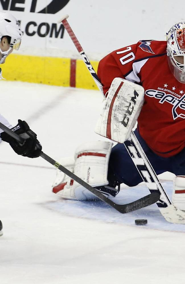 Washington Capitals goalie Braden Holtby can't stop a short-handed goal by Dallas Stars left wing Ryan Garbutt in the third period of an NHL hockey game, Tuesday, April 1, 2014, in Washington. The Stars won 5-0