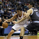 Milwaukee Bucks' ZaZa Pachulia, left, drives against Orlando Magic's Nikola Vucevic during the second half of an NBA basketball game,Monday, March 10, 2014, in Milwaukee The Associated Press