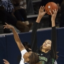 Baylor's Brittney Griner, right, grabs a rebound over Rice's Christal Porter, left, during the first half of an NCAA college basketball game, Tuesday, Nov. 27, 2012, in Houston. (AP Photo/Dave Einsel)