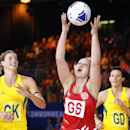 Chelsea Lewis, center, of Wales catches the ball during the netball match between Australia and Wales at the Commonwealth Games 2014 in Glasgow, Scotland, Thursday July 24, 2014