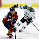Florida Panthers center Nick Bjugstad (27) drives as Dallas Stars center Tyler Seguin (91) defends in overtime of an NHL hockey preseason game, in Sunrise, Fla., Wednesday, Sept. 24, 2014. The Stars won 4-3. The Associated Press