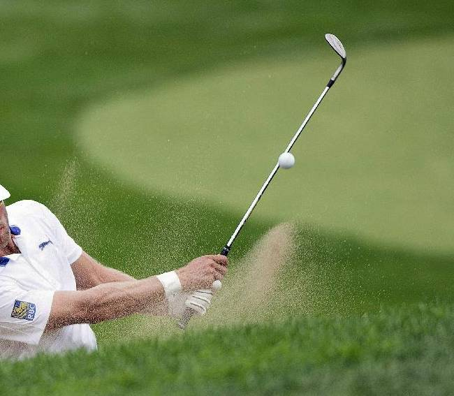 Graham DeLaet, from Canada, plays a bunker shot during a practice round at the Canadian Open golf tournament at Royal Montreal Golf Club in Montreal, Quebec, Tuesday, July 22, 2014