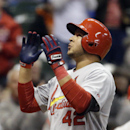 St. Louis Cardinals' Jhonny Peralta looks up as he crosses home after hitting a two-run home run during the ninth inning of a baseball game against the Milwaukee Brewers Tuesday, April 15, 2014, in Milwaukee The Associated Press
