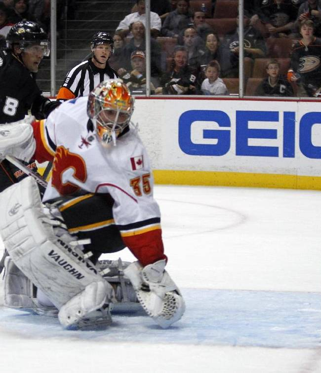 Anaheim Ducks right wing Teemu Selanne (8), of Finland,  scores against Calgary Flames goalie Joey MacDonald, right, during the second period of an NHL hockey game, Wednesday, Oct. 16, 2013, in Anaheim, Calif