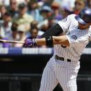 Colorado Rockies' Carlos Gonzalez follows through with his swing after connecting for an RBI-single against the San Francisco Giants in the first inning of a baseball game in Denver, Sunday, May 19, 2013. (AP Photo/David Zalubowski)