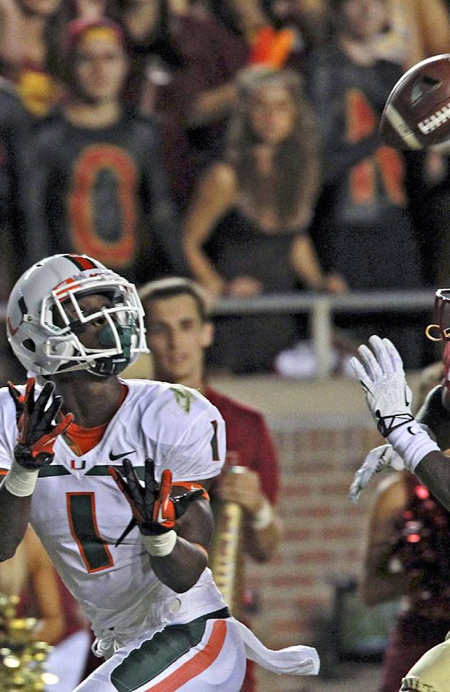 Miami's Allen Hurns catches a touchdown pass as Florida State's PJ Williams defends during the first quarter of an NCAA college football game Saturday, Nov. 2, 2013, in Tallahassee, Fla
