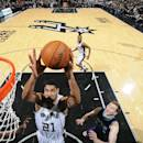 SAN ANTONIO, TX - JANUARY 28: Tim Duncan #21 of the San Antonio Spurs grabs the rebound against the Charlotte Hornets on January 28, 2015 at the AT&T Center in San Antonio, Texas. (Photo by D. Clarke Evans/NBAE via Getty Images)