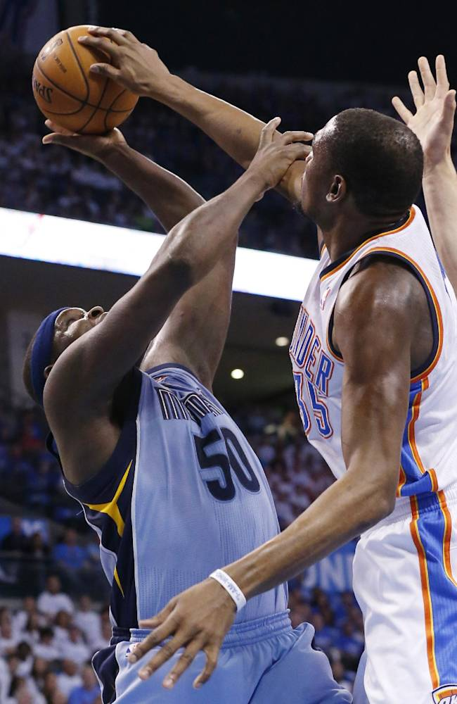 Oklahoma City Thunder forward Kevin Durant  blocks a shot by Memphis Grizzlies forward Zach Randolph (50) in the first quarter of Game 2 of an opening-round NBA basketball playoff series in Oklahoma City, Monday, April 21, 2014