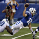 Indianapolis Colts quarterback Andrew Luck (12) throws as he is tackled by Tennessee Titans defensive end Jurrell Casey in the first half of an NFL football game in Indianapolis, Sunday, Sept. 28, 2014. (AP Photo/Michael Conroy)