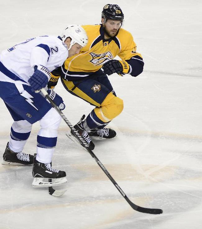 Tampa Bay Lightning defenseman Eric Brewer (2) skates over the stick of Nashville Predators forward Viktor Stalberg (25), of Sweden, as they chase down the puck in the second period of an NHL hockey game, Thursday, Feb. 27, 2014, in Nashville, Tenn