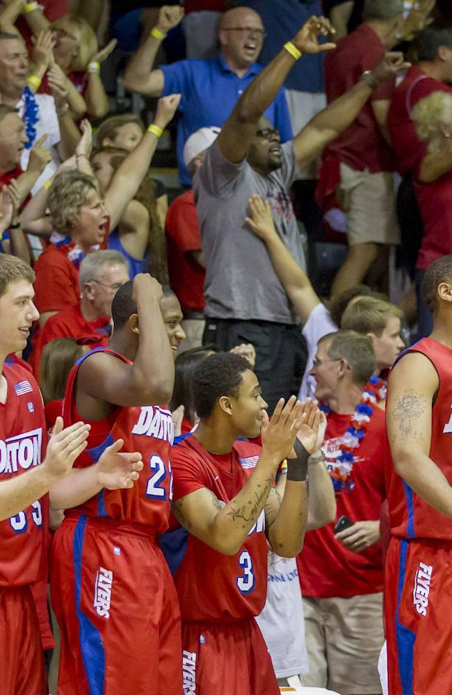 The Dayton bench, along with their fans, celebrate as time counts down on the game clock in the second half of an NCAA college basketball game against Gonzaga at the Maui Invitational on Monday, Nov. 25, 2013, in Lahaina, Hawaii. Dayton upset Gonzaga 84-79