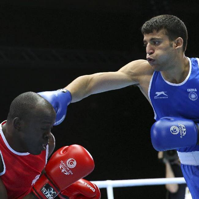 India's Sumit Sangwan, right, lands a right hook on Tanzania's Mohamed Hakimu Fumu during their men's light heavyweight preliminary boxing match at the Commonwealth Games Glasgow 2014, in Scotland, Sunday, July 27, 2014