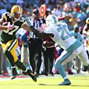 Miami Dolphins Reshad Jones (20) tries to stop Green Bay Packers' Jordy Nelson (87) during final seconds of the second half of a NFL football game in Miami Gardens, Fla., Sunday, Oct. 12, 2014. The Packers won 27-24 The Associated Press
