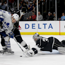 Los Angeles Kings goalie Martin Jones, right, blocks a shot by Toronto Maple Leafs left wing David Booth, middle, as Jarret Stoll (28) looks on during the third period of an NHL hockey game in Los Angeles, Monday, Jan. 12, 2015 The Associated Press