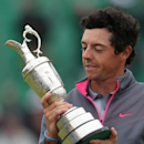 Rory McIlroy of Northern Ireland looks at the Claret Jug trophy after winning the British Open Golf championship at the Royal Liverpool golf club, Hoylake, England, Sunday July 20, 2014
