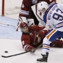 Arizona Coyotes' David Schlemko (6) slides in front of the goal to knock the puck away on a shot from Edmonton Oilers' Ryan Nugent-Hopkins (93) during the third period of an NHL hockey game Tuesday, Dec. 16, 2014, in Glendale, Ariz. The Coyotes defeated t