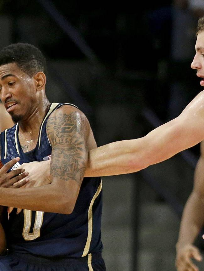 Notre Dame's Eric Atkins, left, steals the ball from Georgia Tech's Daniel Miller, right, in the first half of an NCAA college basketball game, Saturday, Jan. 11, 2014, in Atlanta